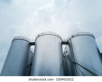 Bulk storage tanks low angle against cloudy skies