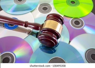bulk writable colorful compact discs background with gavel on top