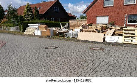Bulky waste on the street is waiting for garbage collection. Waste collection. Bulky trash, a pile of mixed garbage. Recycling industry. Ecology. Recycled materials and wastes