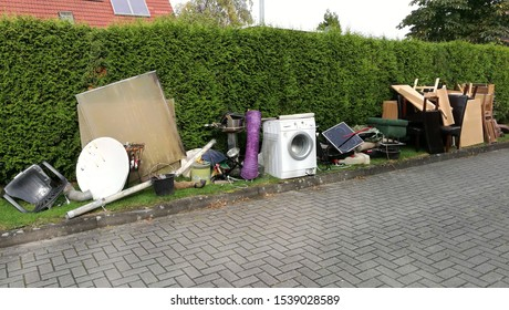 Bulky waste on the street is waiting for garbage collection. Waste collection. Bulky trash, a pile of mixed garbage. Rubbish. Recycling industry. Ecology. Recycled materials and wastes