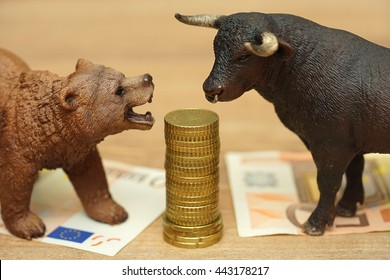 bull and bear and money. investing,risk,stock market,finance,money concept