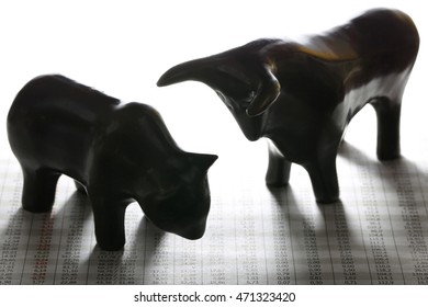 bull and bear at newspaper with stock quotes