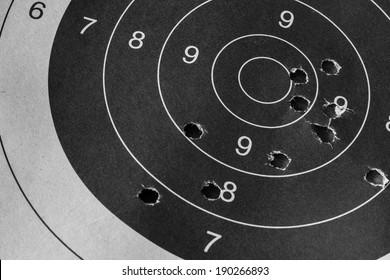 Bull eye target with bullet hole