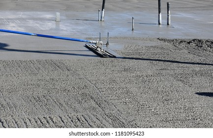 Bull Float Fresh Concrete Surface Prior to Finishing with Trowel
