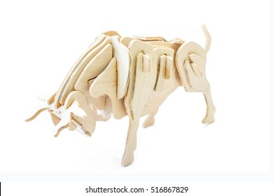 Bull wood jigsaw toy wood on white background.
