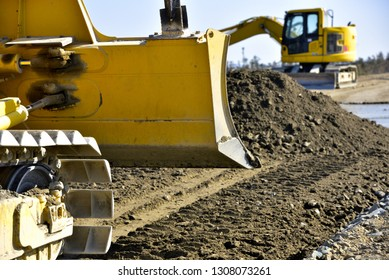 bulldozer blade to extrude earth and sand to leveling: Civil engineering work