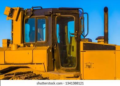 bulldozer cabin, heavy groundwork machinery, ground moving equipment