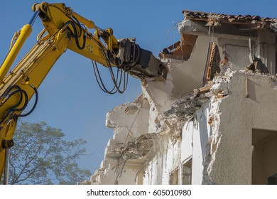 bulldozer demolishing a house