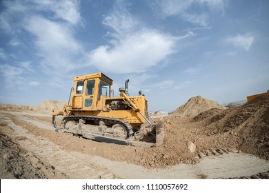 bulldozer dig and cleans the ground