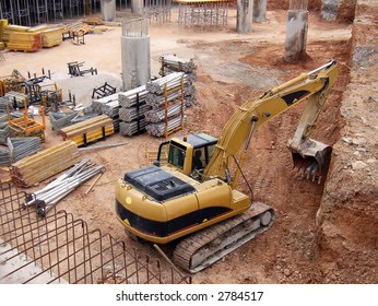 Bulldozer digging in a large construction site