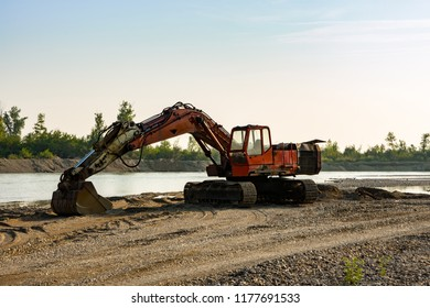 Bulldozer dredger, digs sand on the bank of the river Drina