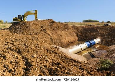 bulldozer excavator  repair  water pipes in construction site