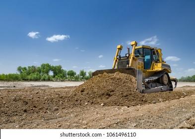 The bulldozer level the ground