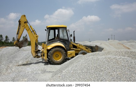 bulldozer lifting small stones