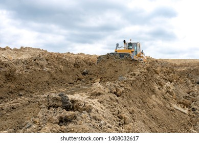 Bulldozer moving marl and limestone on the quarry