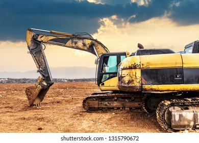 bulldozer on a building site at sunset
