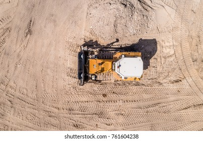 bulldozer on the construction site top view. Shooting from the drone