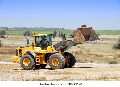 Bulldozer in the road building