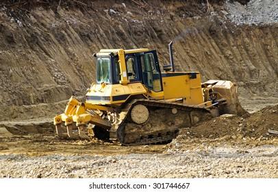 Bulldozer at the road construction