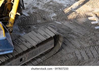 bulldozer track side on sand