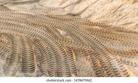 Bulldozer tread. Traces of tread construction equipment on the sand.