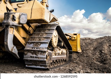 Bulldozer working on Dirt in the Construction Site