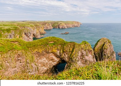 Bullers of Buchan refers to a collapsed sea cave situated about 6 miles south of Peterhead in Buchan, Aberdeenshire, Scotland.