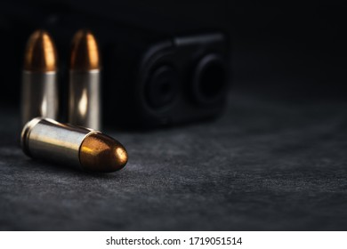 Bullet 9mm. On the dark stone table.rounds and military technology.