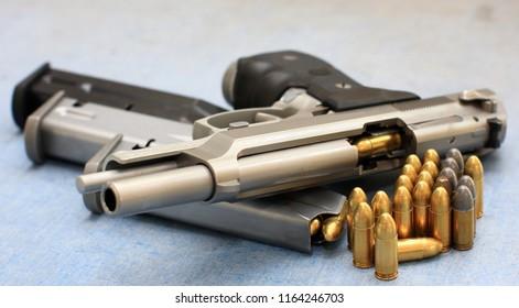 bullet 9mm parabellum and Beretta 92FS, M9 gun barrel