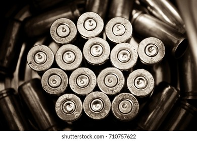 Bullet casings background. Composition from a several shell casings symbolizing army reserve