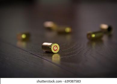 Bullet casings in shadow on floor