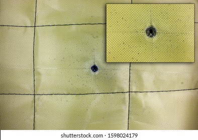 Bullet damage in the Kevlar fabric of the bulletproof vest, after being fired from a Kalashnikov (AKM-74) from a distance of 1 meter (1.09 yards)