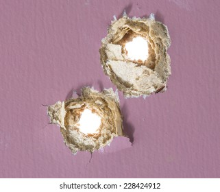 Bullet hole in painted wood