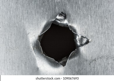bullet hole in sheet metal