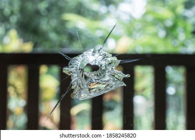 Bullet hole in the window glass
