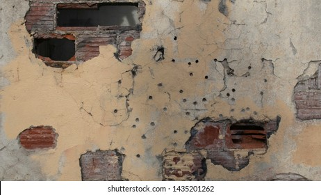 Bullet Holes in Concrete Wall