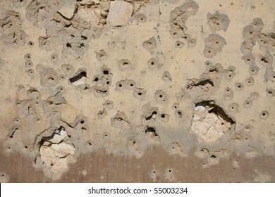 bullet holes on old wall