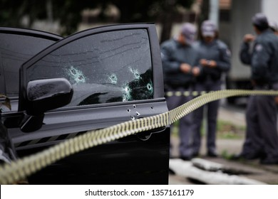 Bullet holes are seen in the window of a car after a armed robbery shot in Sao Paulo, Brazil.