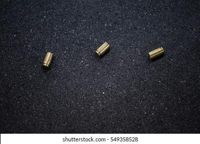 bullet shells ground. Cases of bullets lying on the floor of asphalt