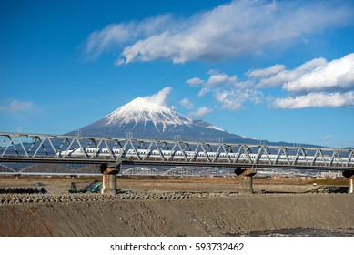 Bullet train Tokaido Shinkansen with view of mountain fuji
