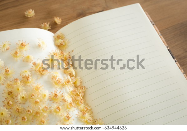 Bullet wood flowers with daily book on wooden table