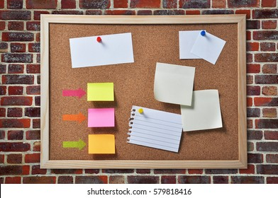 Bulletin board with many blank notice papers on brickwall