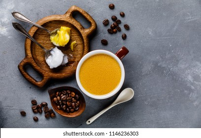 Bulletproof coffee with melted and coconut butter on concrete background copy space
