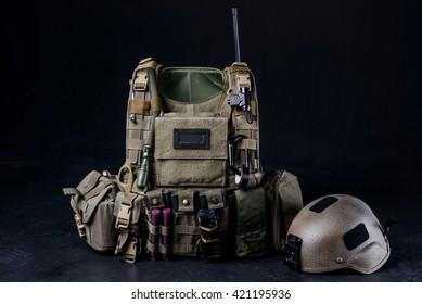 Bulletproof vest,helmet and other military equipment on black background/Body armor covers, bulletproof vest