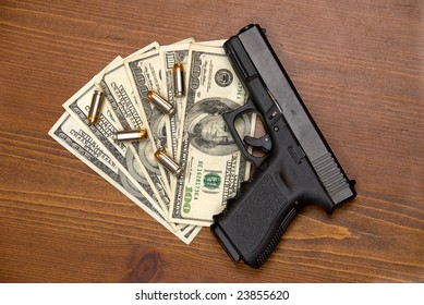 Bullets, cash and a gun on a table.