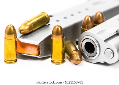 Bullets and guns on a white background.