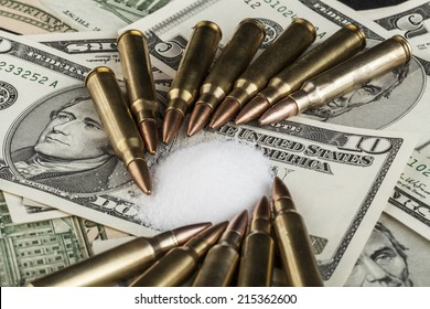 bullets on dollar banknotes with white drug powder