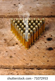Bullets on old vintage wood table with copy space
