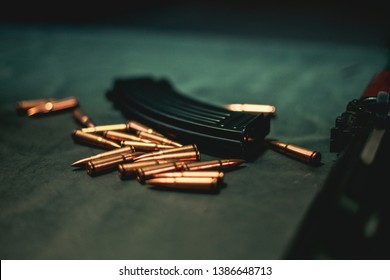 Bullets on a table in a firing range for an AK47 waiting to be loaded