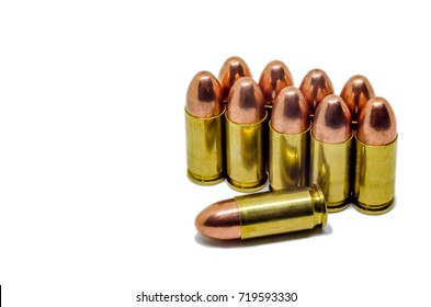 Bullets on white background. A group of 9mm bullets for a gun isolated on white background. Ammunition on white background.